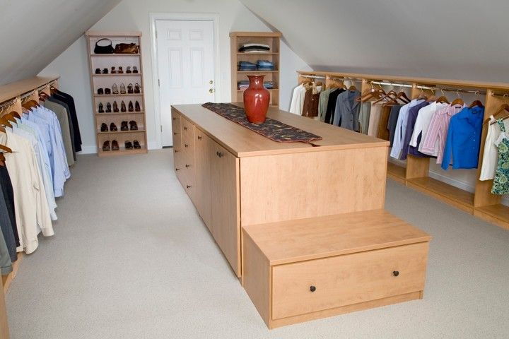 Low And Slanted Roof Dressing Room Idea With Separated Wooden Walk In Closet  Wooden Center Island With Extra Storage And Integrated Wood Bench Of Dozens  Of ...