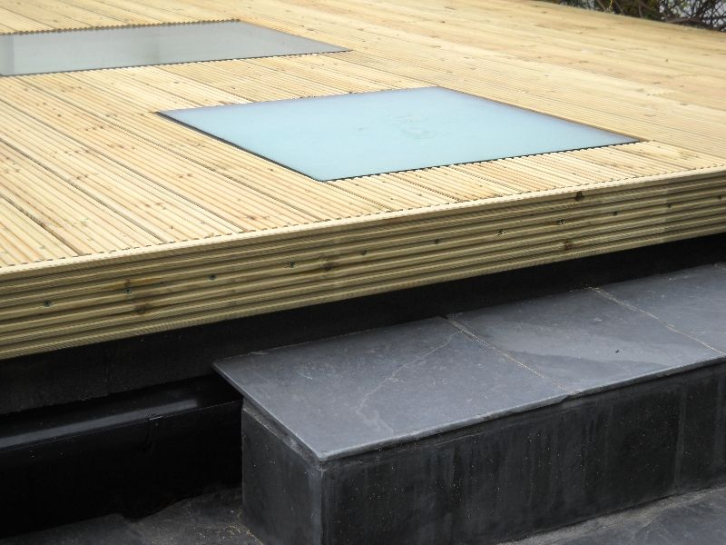 Decking walk on skylight on a flat roof extension for Roof sheathing material options