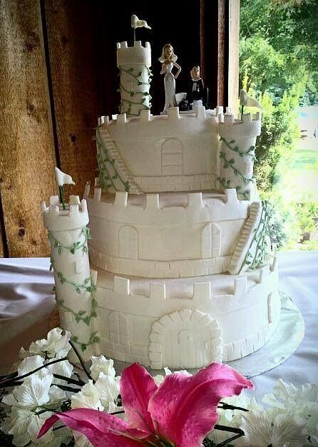 white castle cake with the wedding color incorporated into the ivy facebookcom
