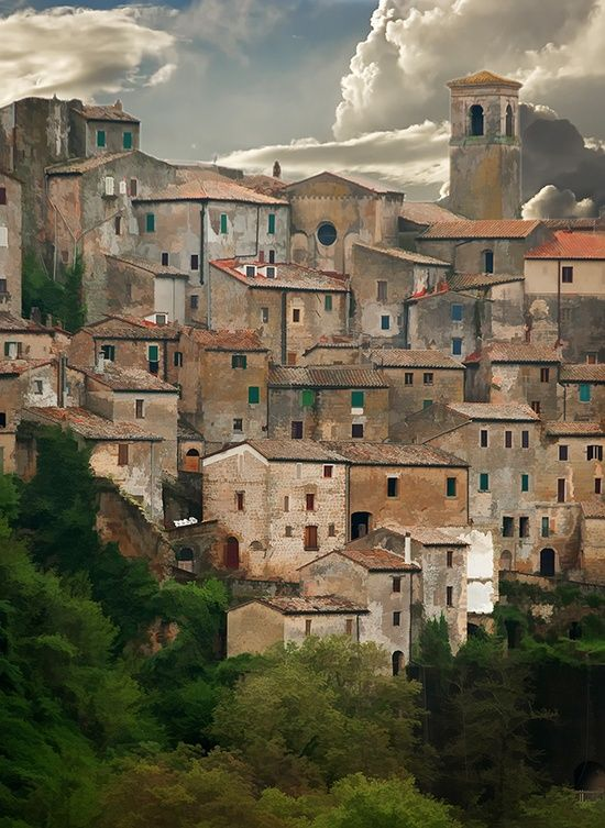 Sorano ~ Tuscany ~ Italy ~ Sorano is a town and comune in the province of Grosseto, southern Tuscany. It as an ancient medieval hill town hanging from a tuff stone over the Lente River.