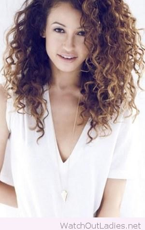 Sweet curly hair and white V-neck tee and a golden necklace