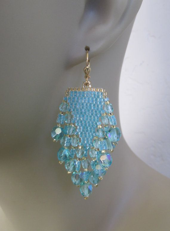 These gorgeous & medium weight earrings are handmade with color lined aqua AB & golden delica & rocaille seed beads, with 4mm & 6mm Czech Fire-polished beads in aqua AB.  They measure just a touch over 2-1/2 long which includes the plated leverback earwires.