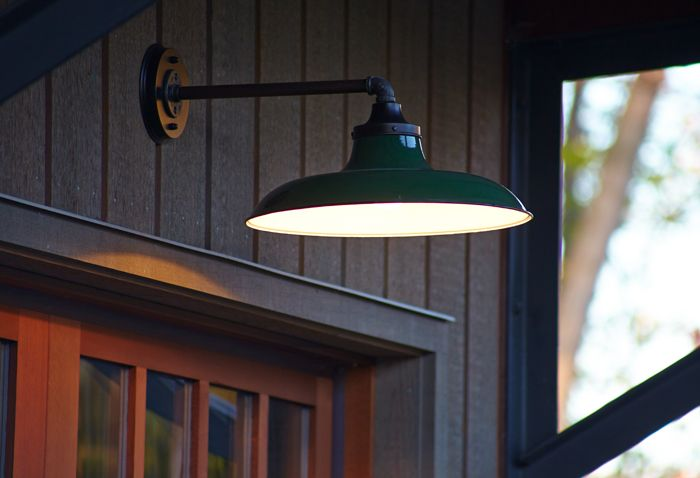 Close Up Of Vintage Transitional Light Fixture Providing Exterior Lighting