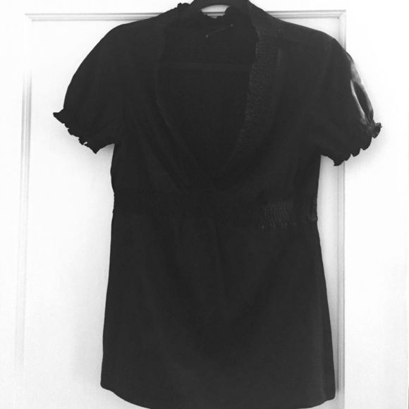 SALE! NWOT black silk Vneck from BCBG. Super chic! Black silk top with gathered detail for a flattering fit. Gorgeous! BCBG Tops