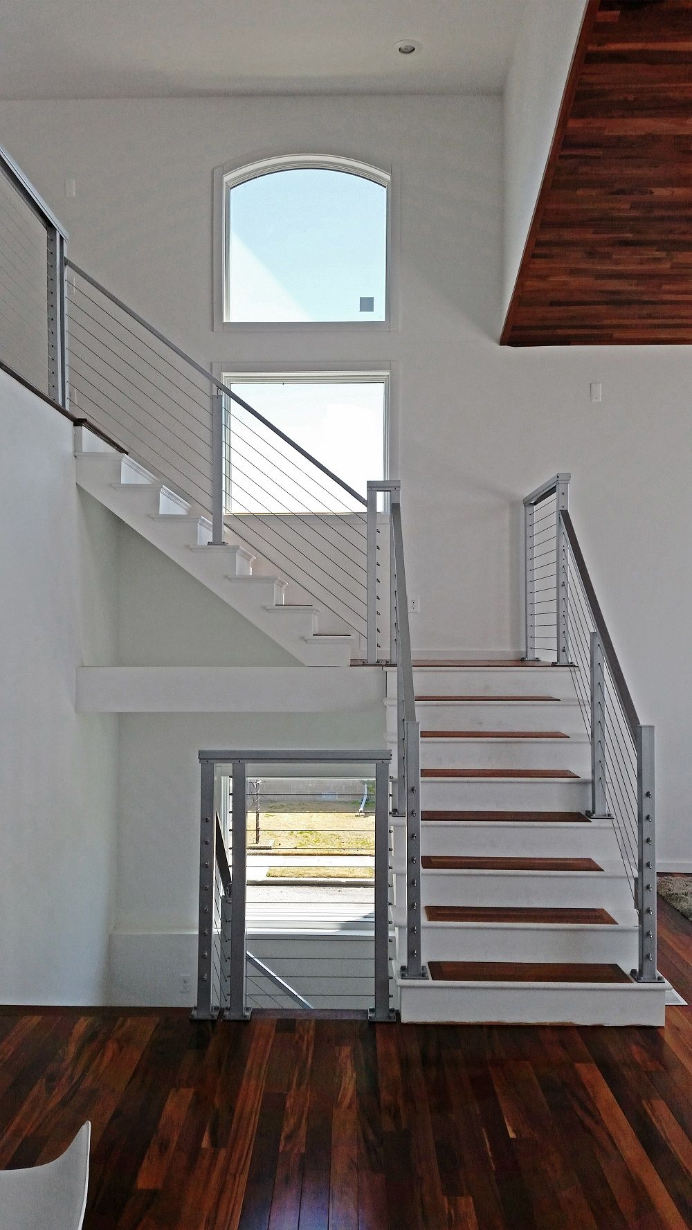 Cable stair railing square stainless steel posts and handrail with cable infill by cable railing direct