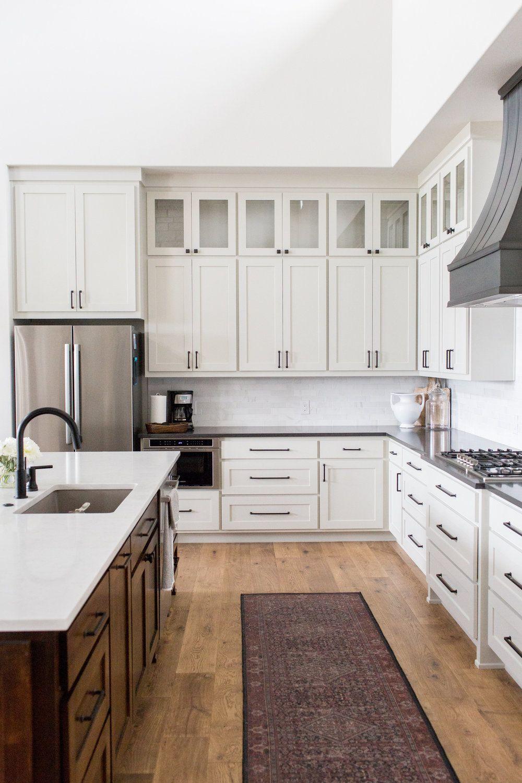 Double Height Ceilings Vintage Runner Large Island Sink In Island Dark Island Cabinets Dark Interior Design Kitchen Kitchen Design Black Countertops