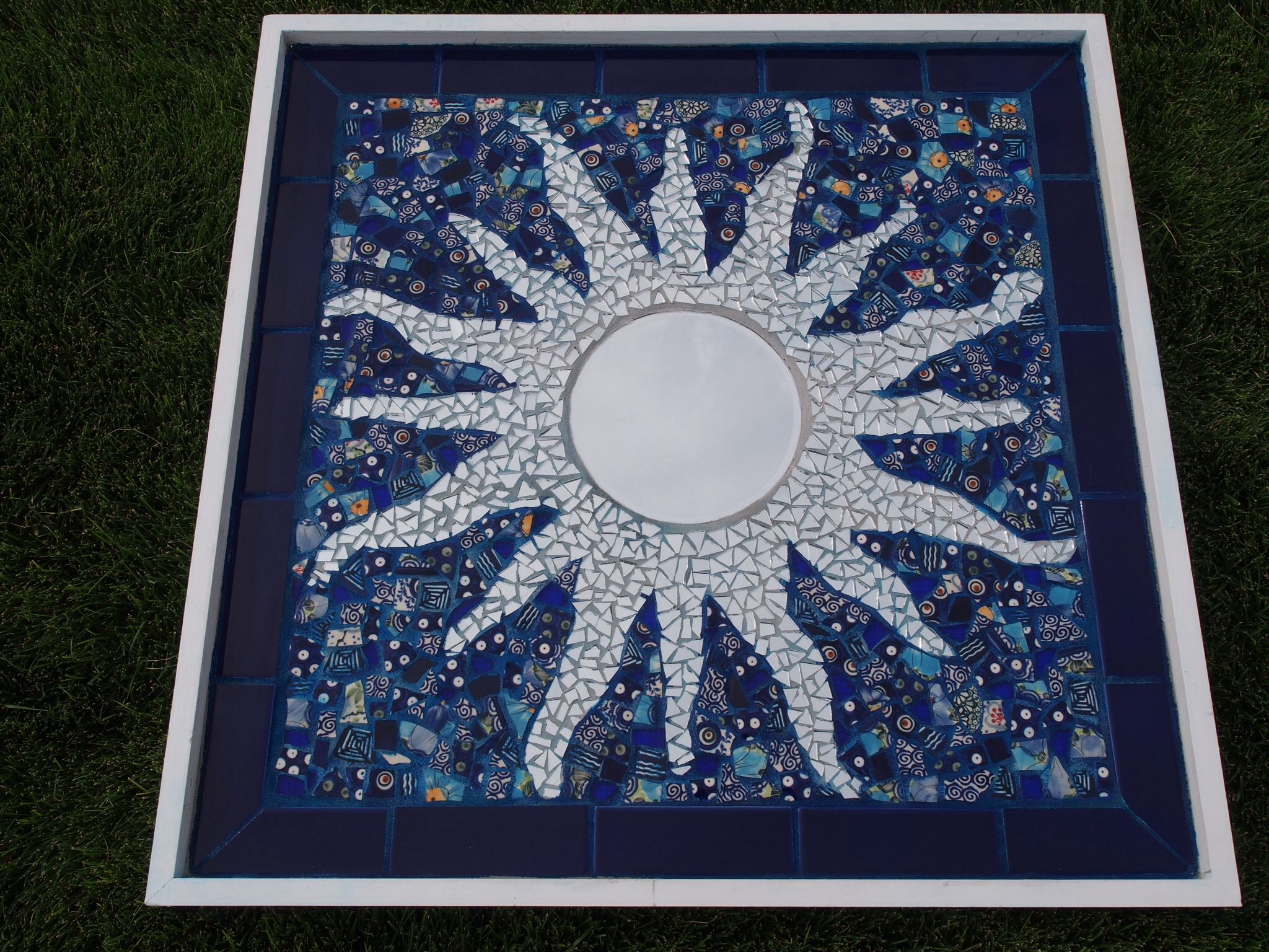Sun mosaic by Paula Bashforth. 30 by 30 inches. Mirror, broken ...