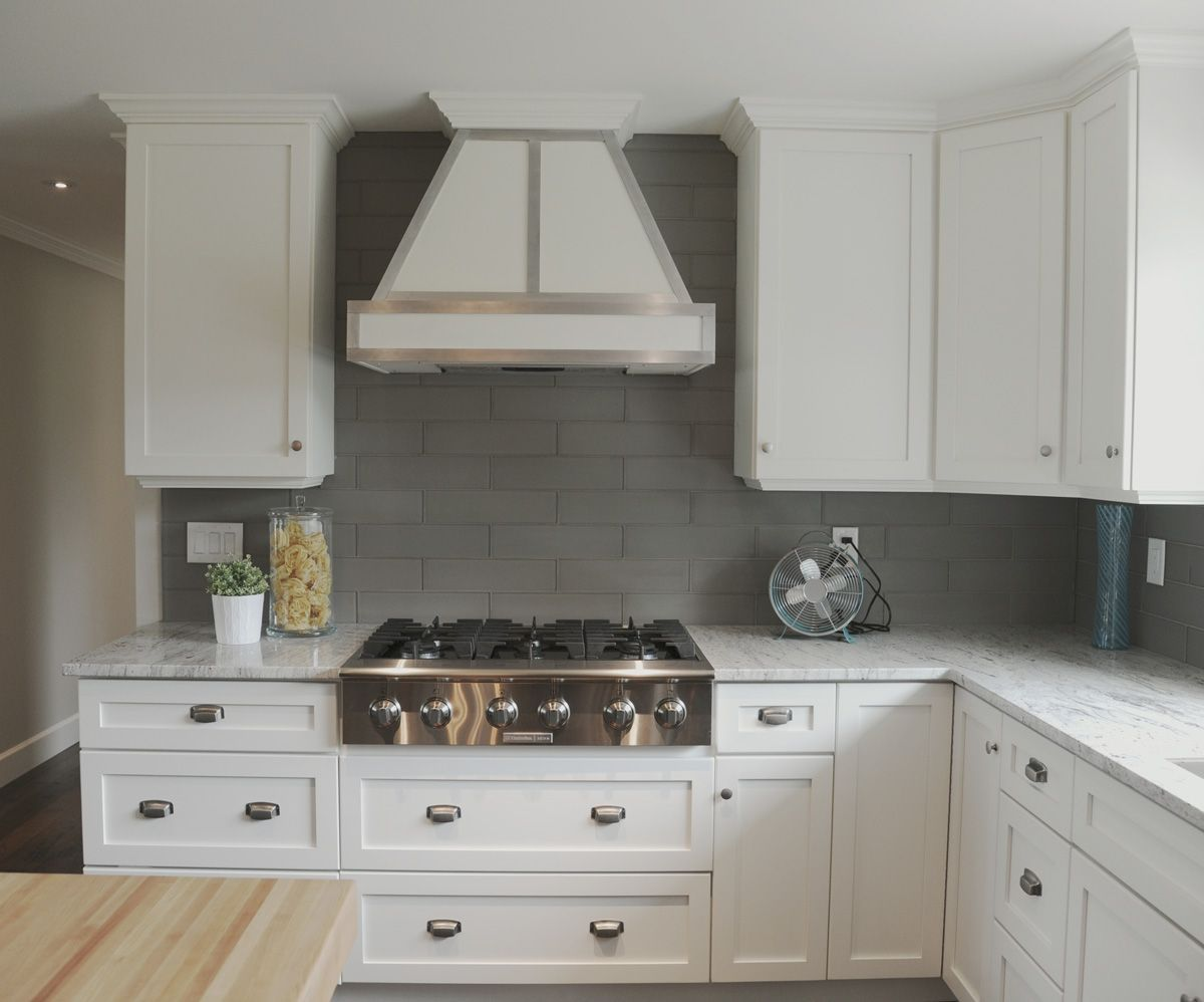 White Cabinets, Metal Detail On Hood Fan, Frosted Glass Subway Tile .