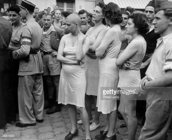 A group of Frenchwomen, who had been accused of collaborating with the Germans, stripped down to their underwear, some with heads shaved, as part of their public humiliation.