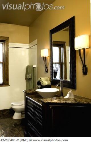 BATHROOM: Bright mustard colored walls, brown granite ...