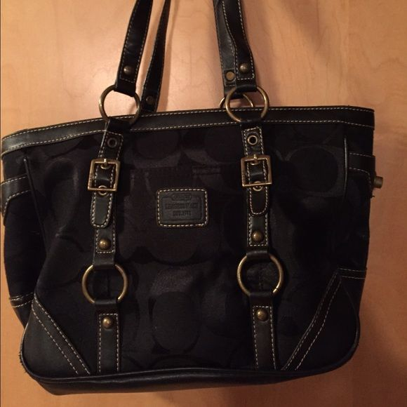 "Black coach canvas tote PRICED TO SELL. Authentic black Coach canvas tote. Used condition but still looks great. The color is a little faded (but you can barely tell) and there is very slight fraying (pictures). Clean! No stains inside or out. 13"" wide 9"" high 10"" strap. Coach Bags Totes"