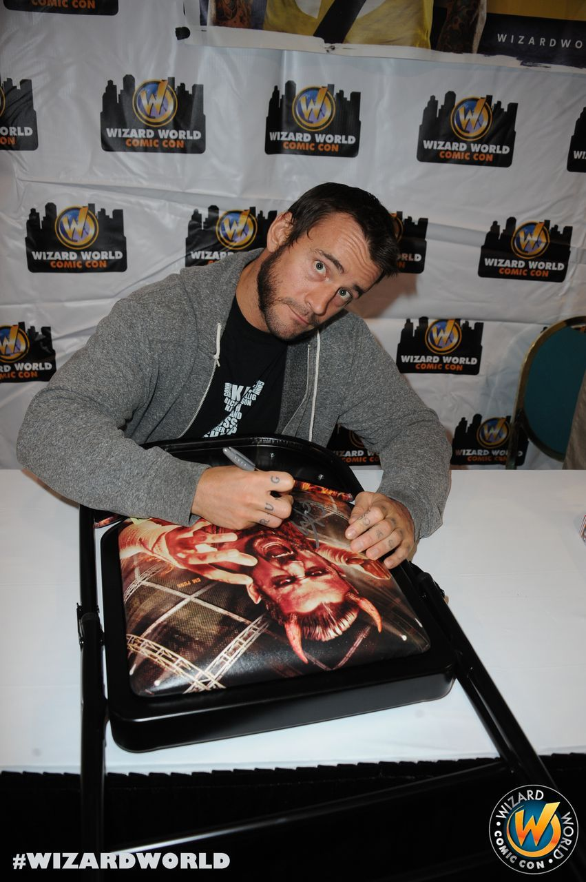 CM Punk signing autographs for fans! Check out Wizard World Ohio Comic Con Sep 20-22, 2013!! Click http://www.wizardworld.com/home-ohio.html
