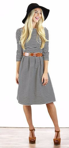 Cute black and white striped knee length boat neck modest dress. Would be great office attire as well!