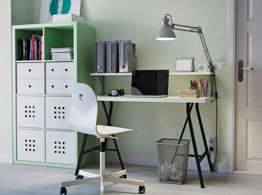 A home office with mint green kallax storage linnmon table in