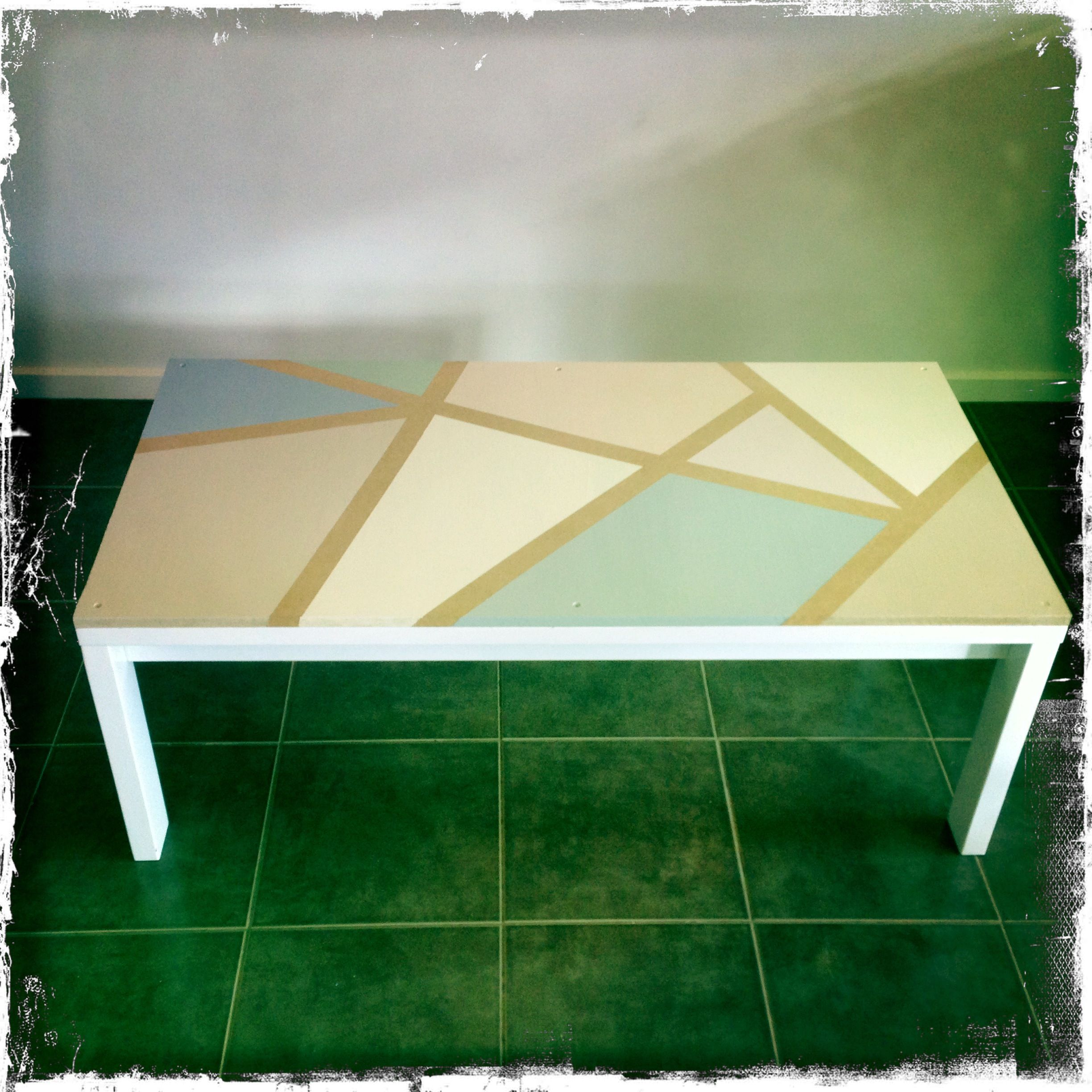 easy diy table top design  using tape on a plywood surface