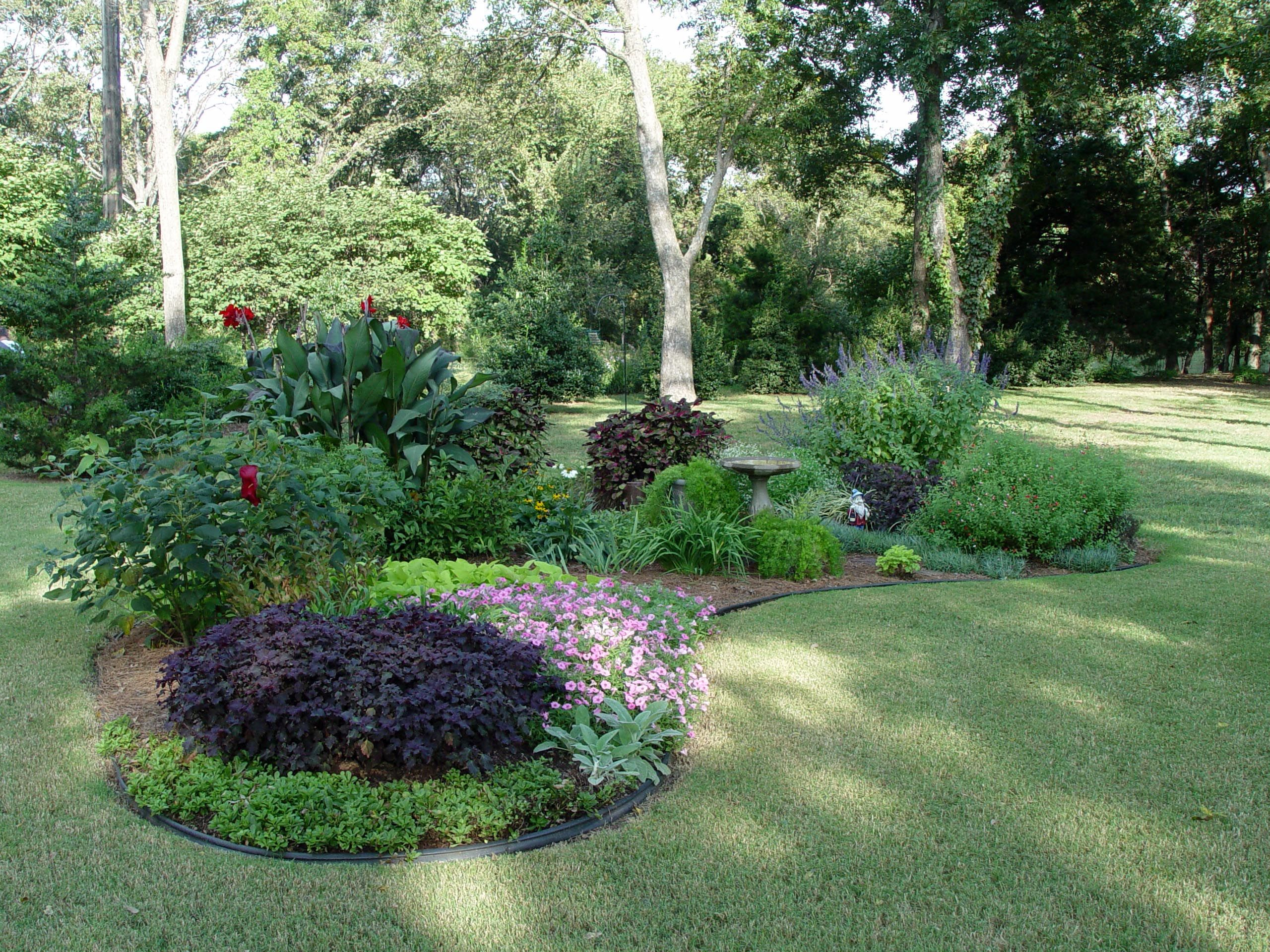 Design an island bed yards shapes and front yards for Flower garden landscape