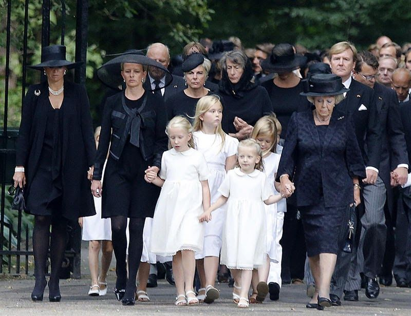 MYROYALS  FASHİON: Prince Friso' s funeral at the Stulpkerk in Lage Vuursche, Netherlands, August 16, 2013-front-Queen Maxima, Princess Mabel, Countess Luana, Countess Zaria, Princess Beatrix; behind-King Harald of Norway (Friso's godfather), Princess Laurentien, Amalia, Princess of Orange, Princess Alexia, King Willem-Alexander, Prince Constantijn.