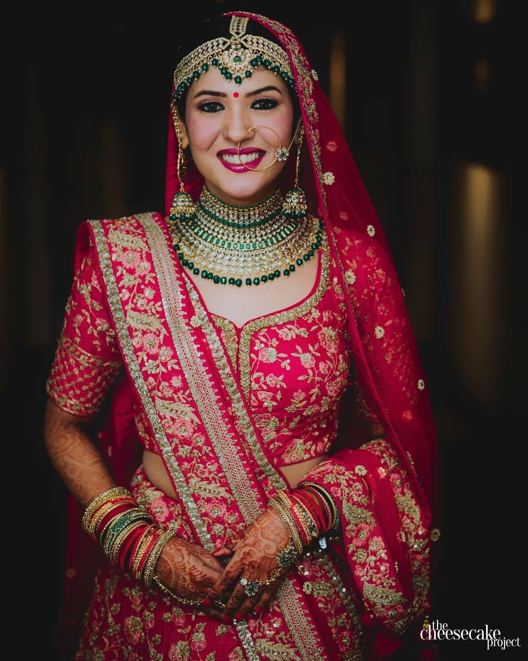 Red Bridal Lehenga With Green Jewellery Set