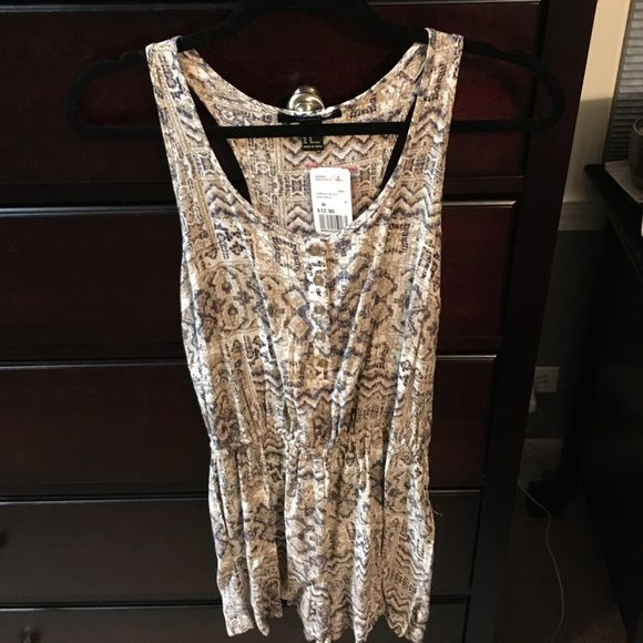 Tribal print romper Cute/soft tribal print romper! Never worn, new with tags and extra button. Forever 21 Other