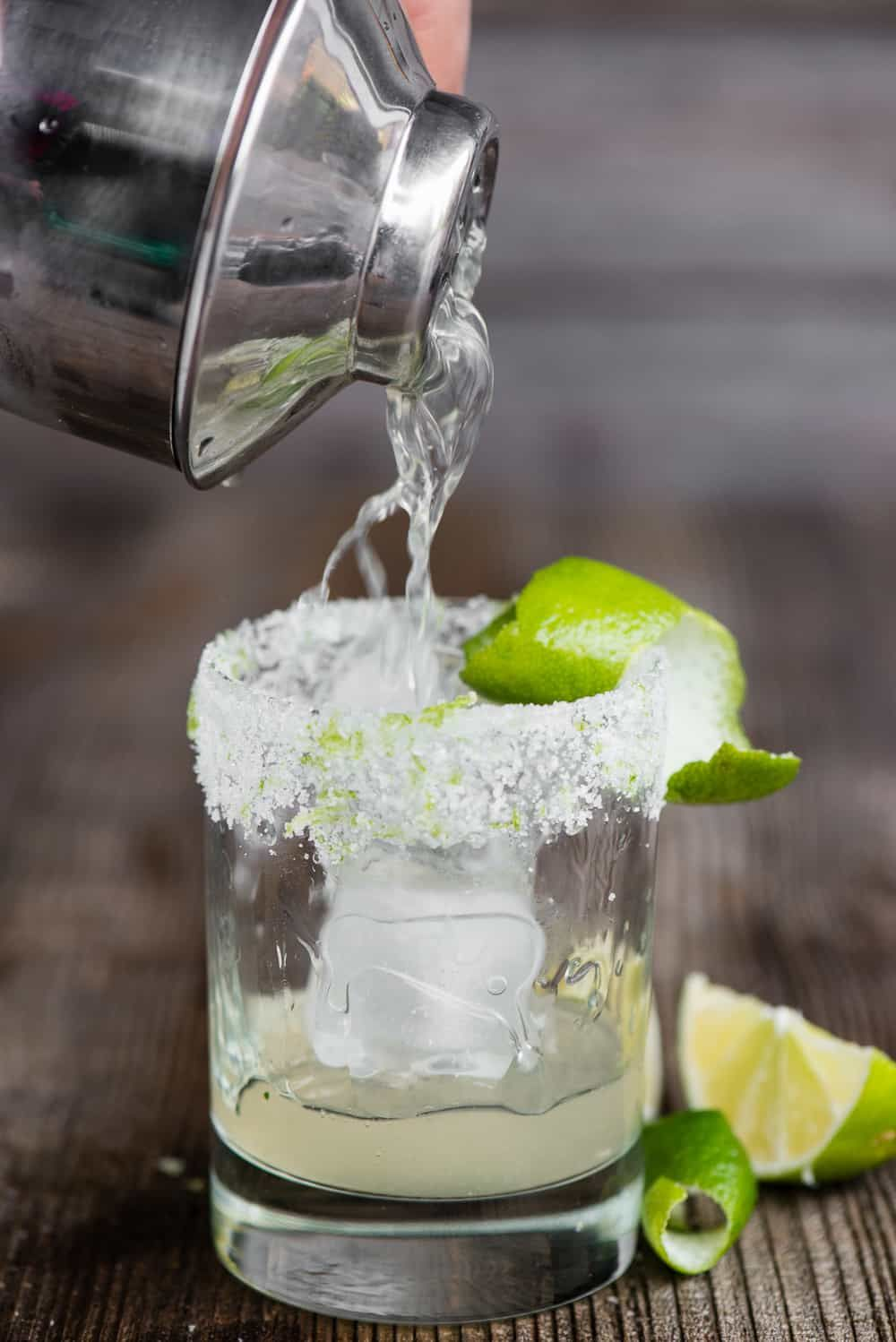 The most perfect classic Margarita recipe is quick and easy to make. This lip smacking tequila cocktail served over ice is the best drink!