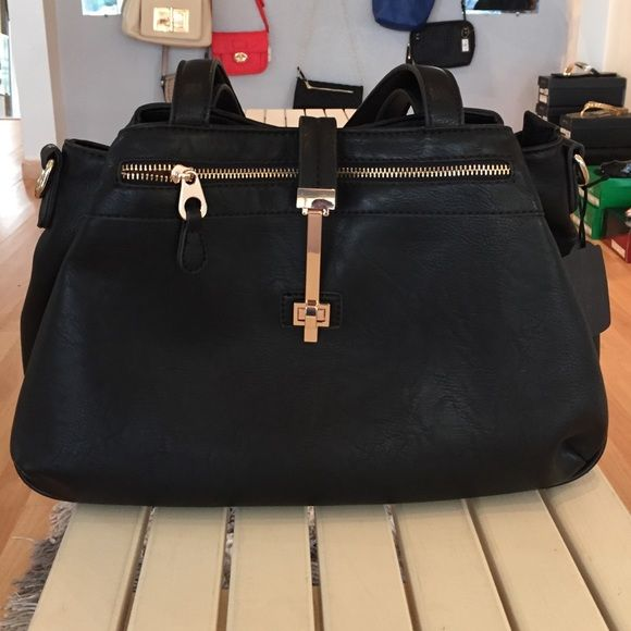 NWOT Roomy Black Purse Gold Accents Shoulder Strap Beautiful and very roomy black purse with shoulder strap included. Has a zipper pocket in front and this secure bag has a lock in front plus top zipper. It also has additional pockets on each size of zippered area. See third pic. Bags