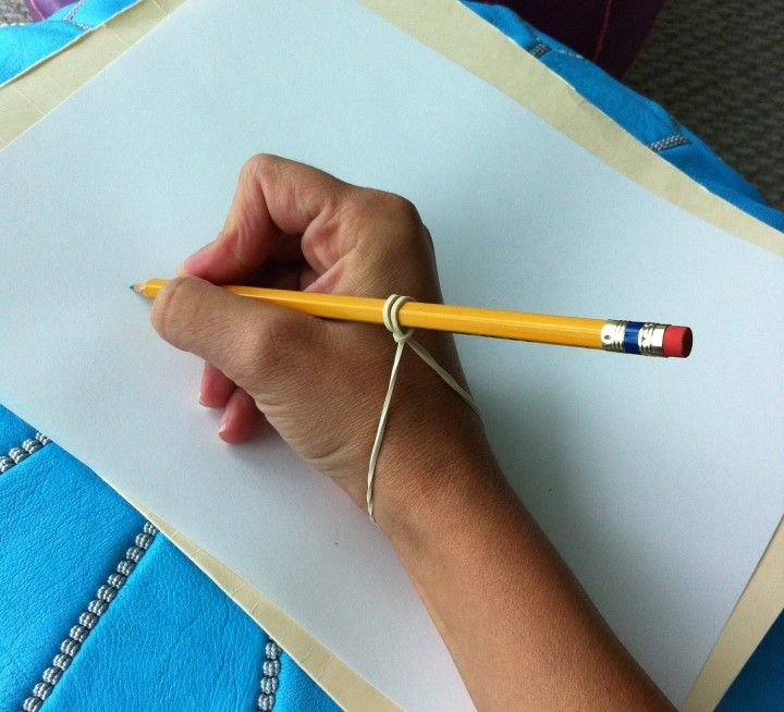 Correct perpendicular pencil grasping using rubber bands.