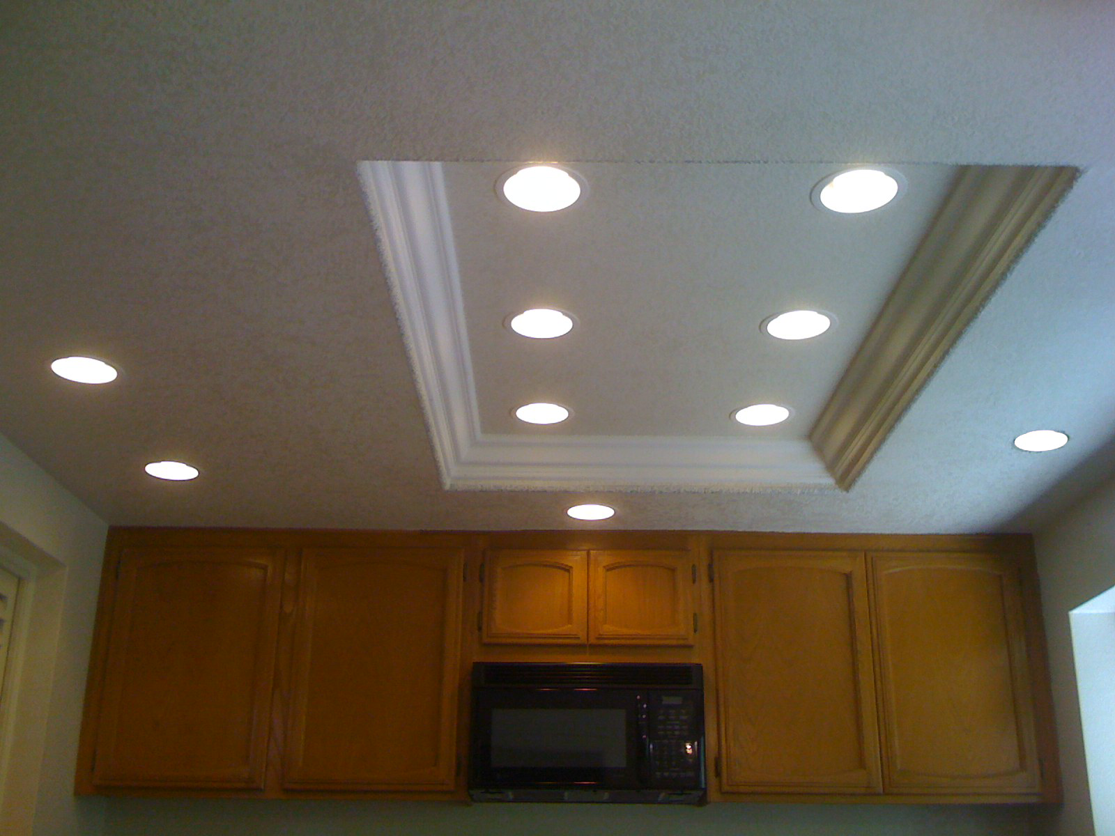 good idea for replacing fluorescent light with recessed lighting in