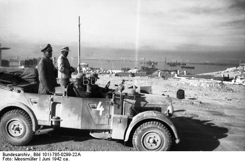 North Africa, Tobruk, June 1942  -. Erwin Rommel and Fritz Bayerlein when driving in open car (Horch car 15?), In the background the ultimate prize for both sides - the vital supply port.
