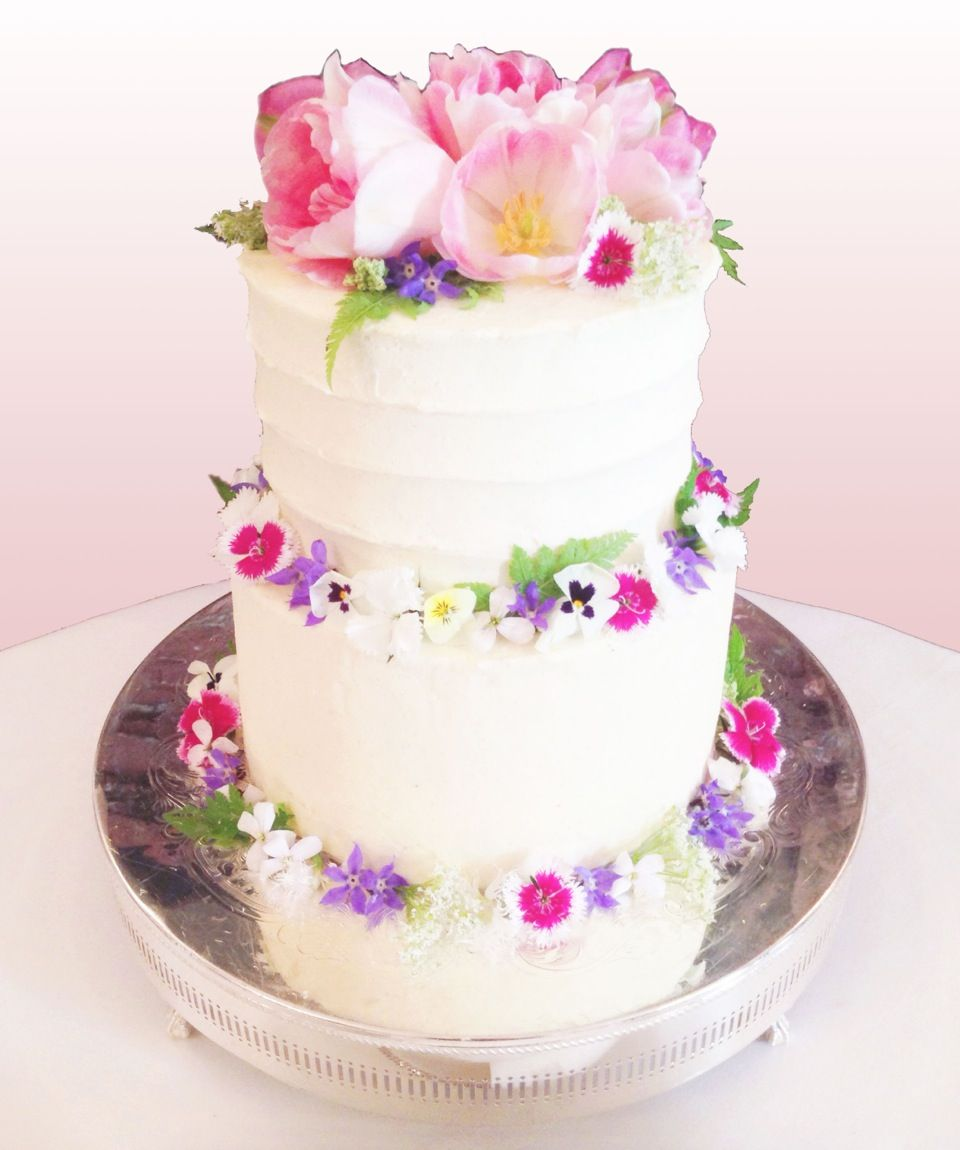 Spring wedding cake decorated with edible tulips and other edible