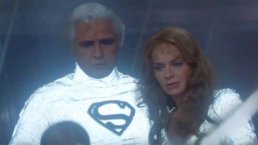"""Marlon Brando played Jor-El in the 1978 film Superman, which Alexander Salkind, his son Ilya Salkind, and their business partner Pierre Spengler produced and which Richard Donner directed. In the movie, Jor-El is shown wearing the iconic """"S""""-shield symbol as the family crest of the House of El, resembling an Earth """"S"""" by coincidence."""