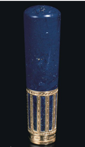 GOLD-MOUNTED LAPIS LAZULI PARASOL HANDLE BY FABERGÉ, WITH THE WORKMASTER'S MARK OF HENRIK WIGSTRÖM, ST PETERSBURG, 1908-1917, SCRATCHED INVENTORY NUMBER 24701 The tapering cylindrical lapis lazuli handle mounted with gold cagework, engraved with geometric motifs, marked on lower collar, in the original velvet and silk-lined fitted case, stamped 'Fabergé St Petersburg Moscow London' beneath the Imperial warrant. Image Christies