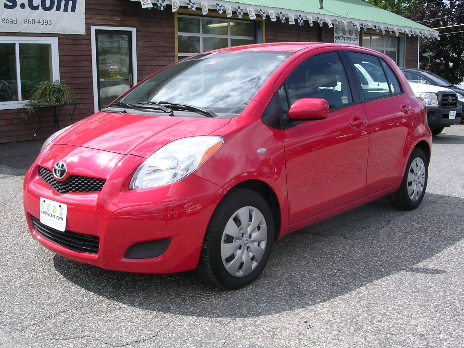 My 22nd and current vehicle a red 2009 toyota yaris 4 door hatchback 4