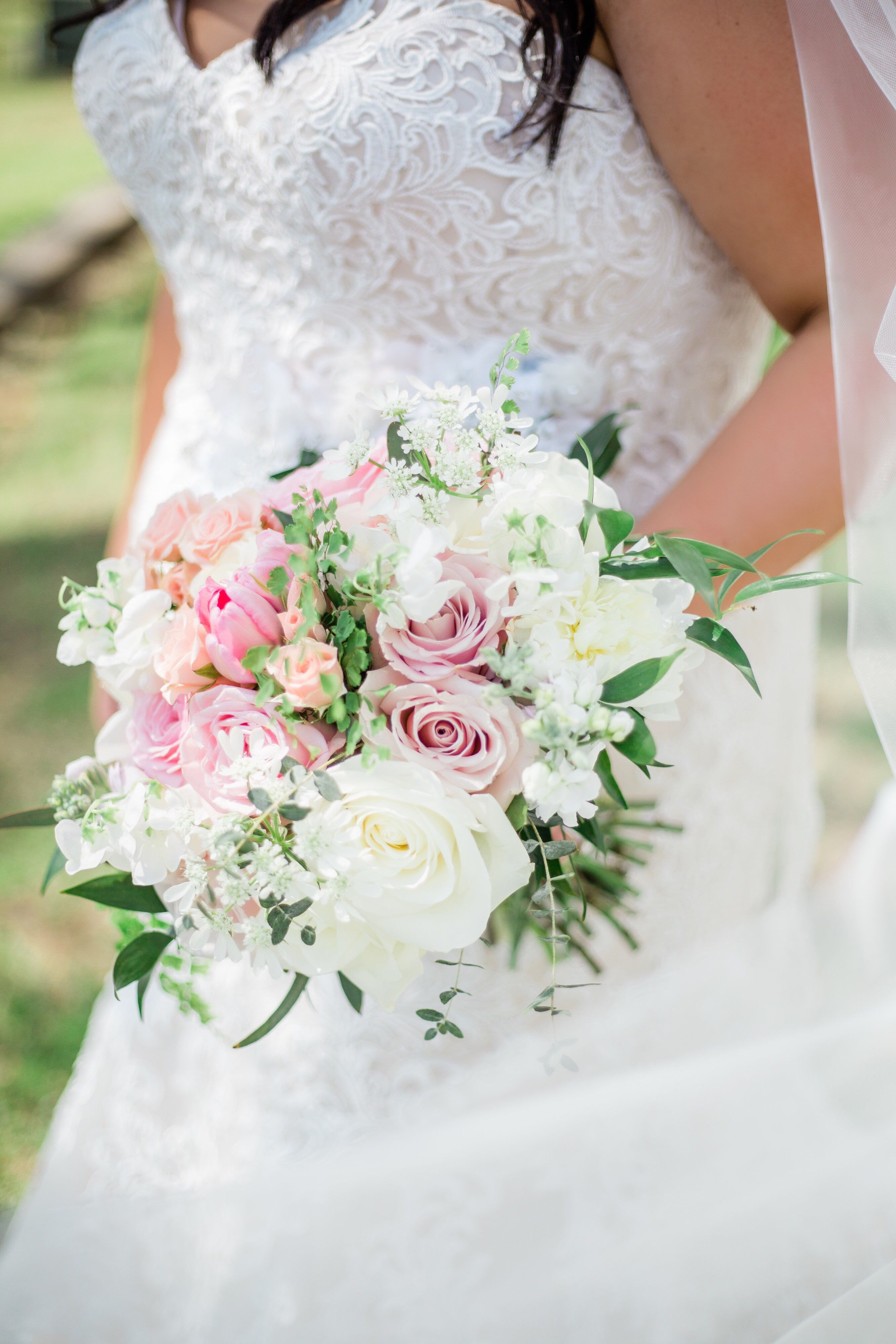 Beautiful summer wedding bouquet of light pink and ivory