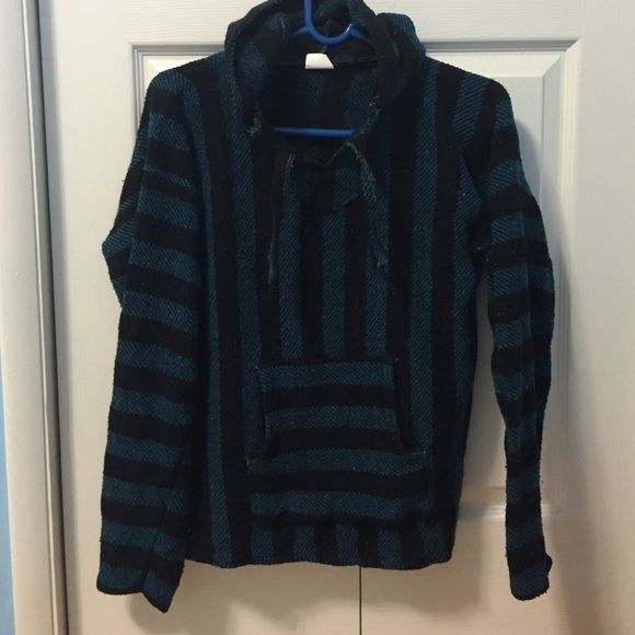 Turquoise and black No stains never worn. YOUTH LARGE. FITS ADULT SMALL Sweaters