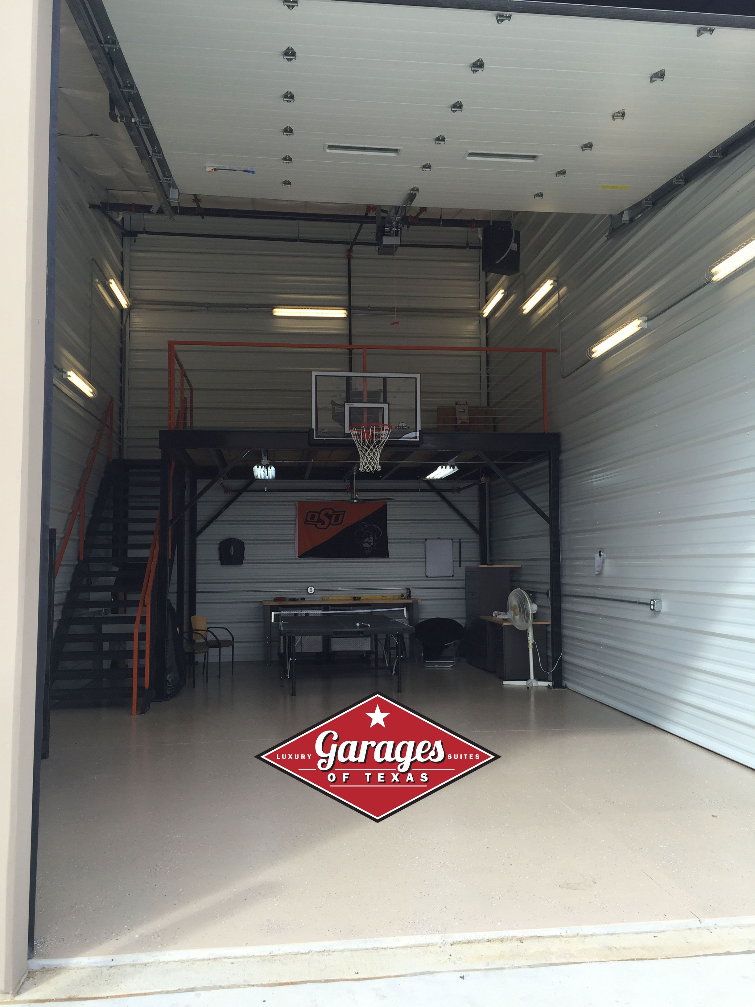 This person thought of everything with their mancave for Garage mezzanine ideas