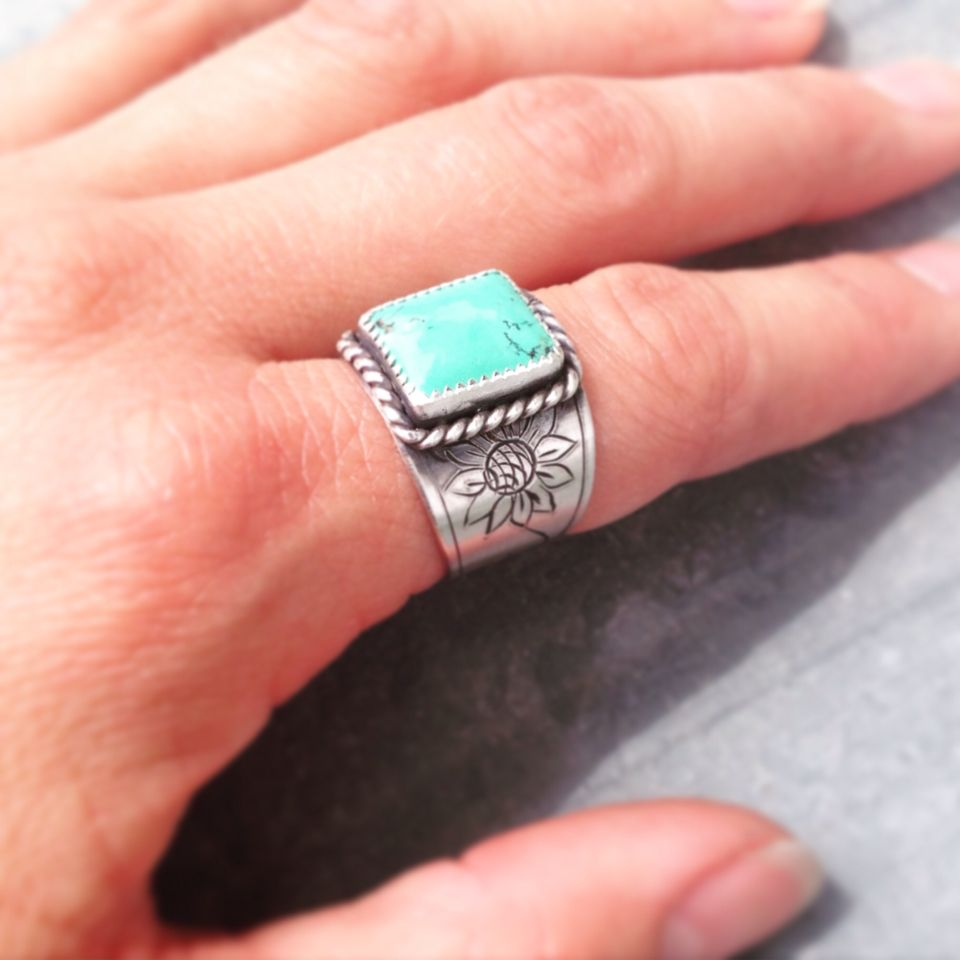 Sterling and turquoise ring with engraved sunflowers made by Silo