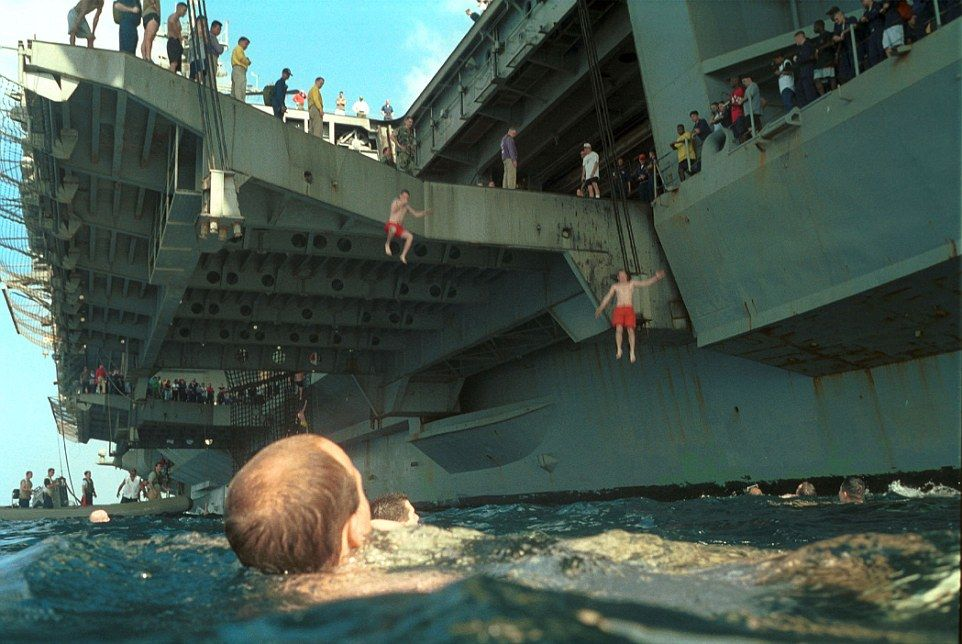 Sailors Leap From Ships Around The World During Us Navy Swim Call Aircraft Carrier Navy Aircraft Carrier Us Navy