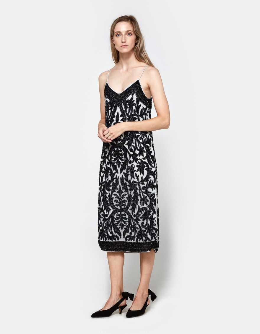 16882371 Evening dress from Ganni in Pearl Blue. Sequined damask pattern.  V-neckline. Thin straps. Straight hem with side slits. Lined. Mid length.