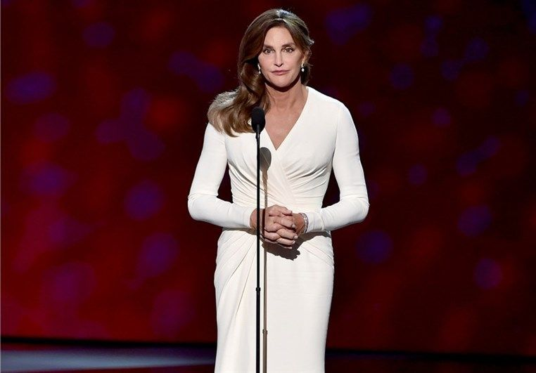 Pictures of Caitlyn Jenner who chose to wear Atelier Versace while accepting the prestigious Arthur Ashe Courage Award at the 2015 ESPY Awards held on July 15th 2015 in Los Angeles. The former Olympic athlete was a vision, in a white long-sleeved, silk cady gown with delicate ruched detailing at the waist and subtle train.