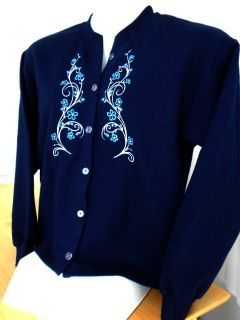 Ladies navy blue sweatshirt jacket with floral swirl embroidery on each side of the front opening. This is a truly unique one-of-a-kind jacket--beautiful, but oh, so practical; just the right combination of warmth and style. The navy blue looks particularly nice over a tee shirt and paired with jeans, or particularly sharp with gray slacks. It can be paired with just about anything in your wardrobe. And the beautiful floral embroidery designs add a true touch of class. This is the jacket ...