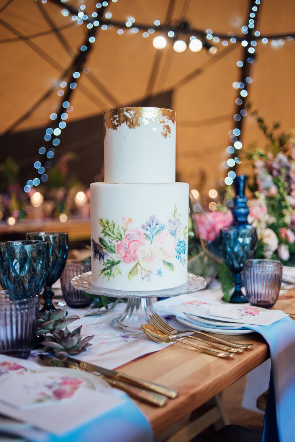 Painted wedding cake from edible essence world inspired tents tipi hire for weddings south west england wales tipi hire rock my wedding the list tipi