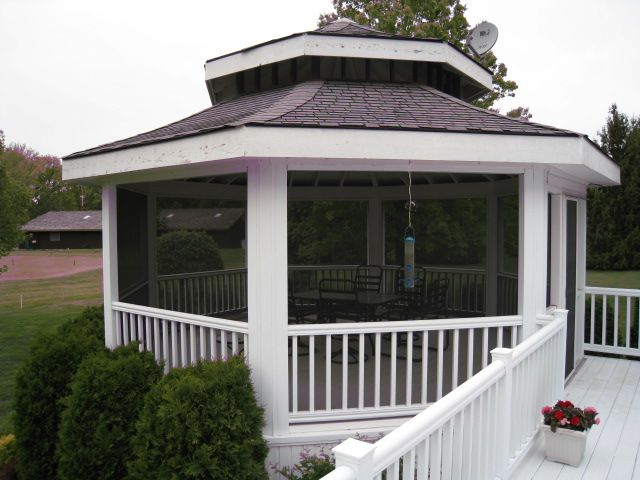 Screened in deck with a classic gazebo enclosure for a for Deck with gazebo
