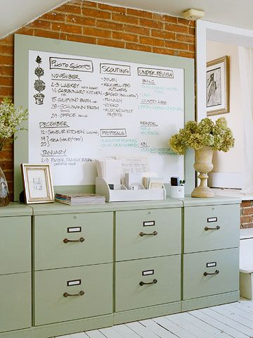 green file cabinets + dry erase board