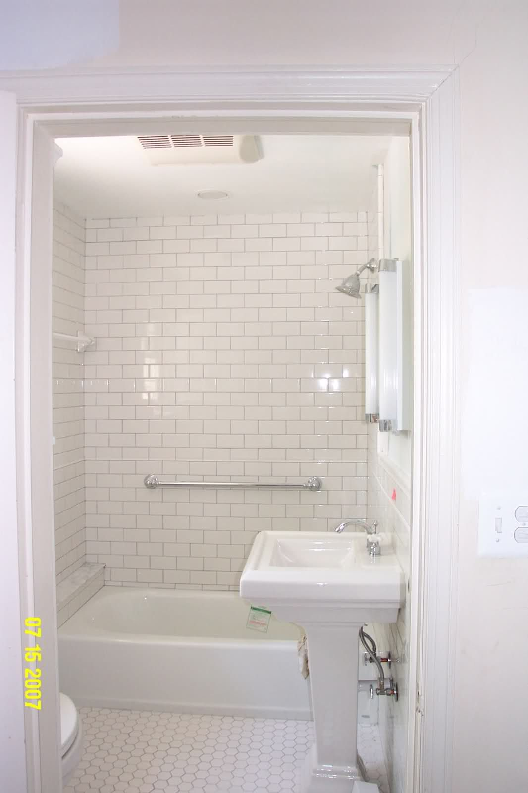 Timeless Bathroom White Subway On The Walls And White Hex On The