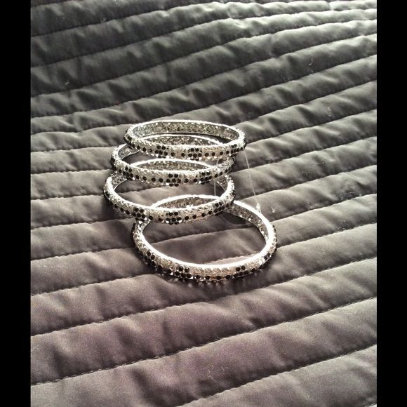 Never worn black and silver bangles Black and silver rhinestone bangles. Never worn and still shiny. The tag fell off but the plastic is still in bangles keeping the together like purchased. Please use offer button  Accessories