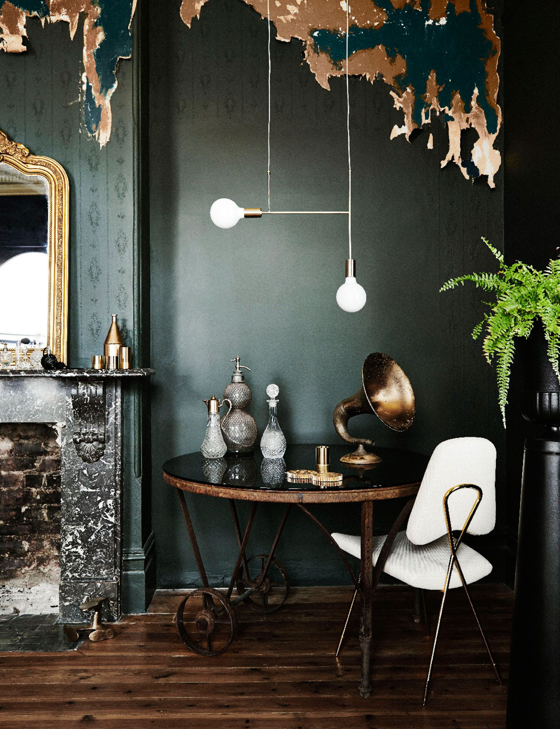 Bronze Accents And The White Light Fixture With Chair