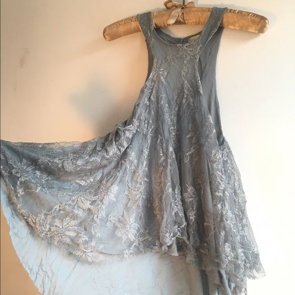 Free People flowy lace tank Pretty and delicate, this two layered lace and cotton tank accentuates your shoulders and neckline. Great condition. Will be steamed and ironed before shipping. Free People Tops Tank Tops