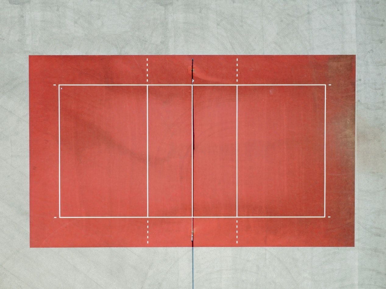 A Drone Shot Of A Red Tennis Court Fun Workouts Volleyball Composition Photography