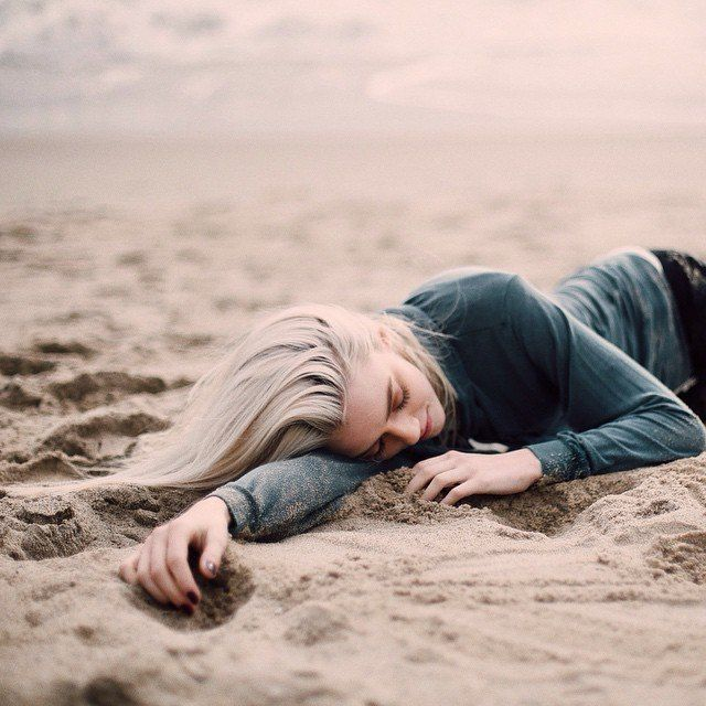 (Open Rp. Perfer mateless wolves) I sigh and lay and the sand, playing with it. I close my eyes a little, listening to the ocean. I hear footsteps and I look up to see you.