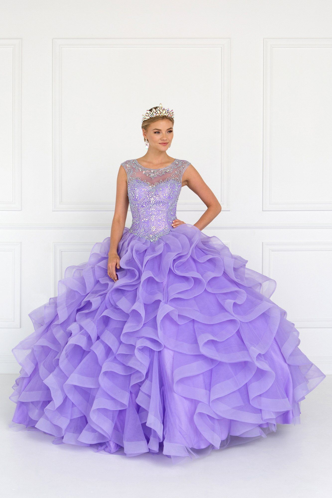 4b5ebfddadf Be the belle of the ball in a beautiful quinceanera dress with sheer  illusion cap sleeve. A purple quince dress with lace up corset back and  puffy